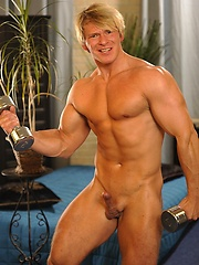 Muscled blond shows his ass