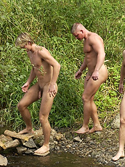Mucled scouts naked outdoors