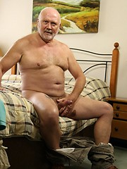 Stewart Scot plays with is uncut cock