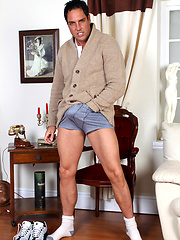 Marcello puts his hands in his blue boxers and rubs his big dick.