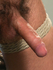 A straight stud gets tied up, suspended and have his hole stretched with the dildo.