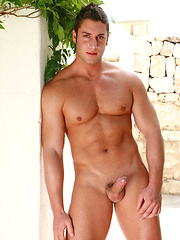Handsome muscle stud posing outdoors