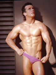 Muscle brunette man posing naked
