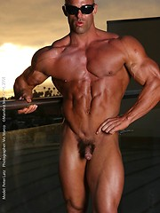Athlete Peter Latz posing naked on a balcony