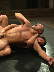 A professional cage fighter wrestles a big-dicked stud for the right to pound his sweet hole.